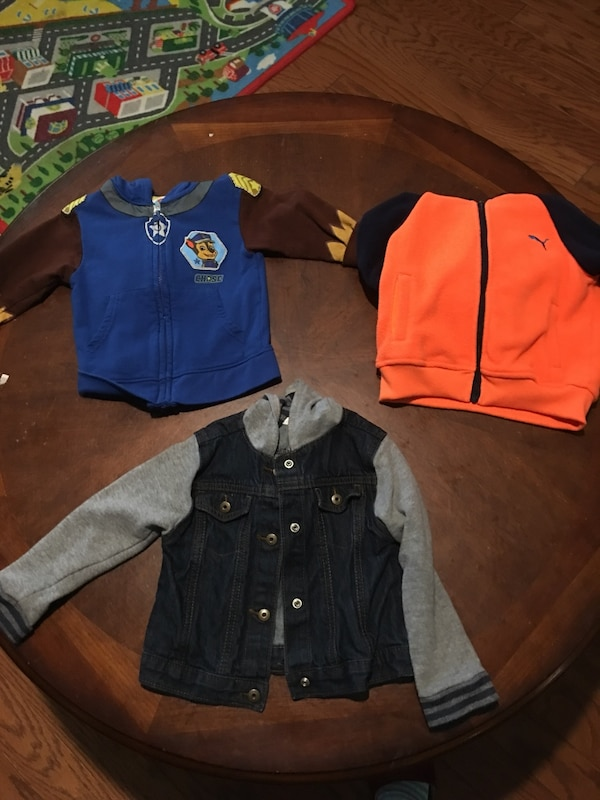 three assorted color zip-up jackets