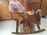 Brown wooden rocking horse toy