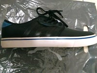 unpaired black and white Adidas low top sneaker Niagara Falls, L2H 1H5