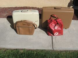 Two Suitcases with bags.