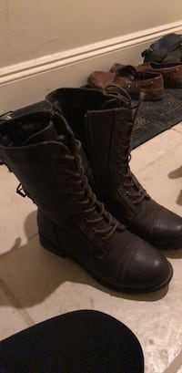 pair of black leather combat boots 1960 km