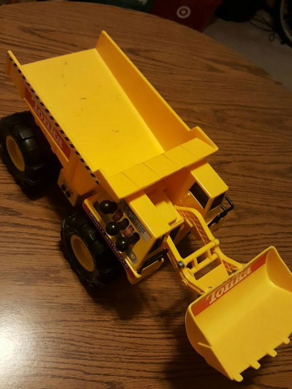yellow and black front loader truck toy