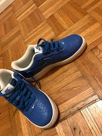 blue-and-white Nike basketball shoes 531 km