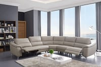 Grey leather sectional with two power recliners all real leather West Melbourne, 32904
