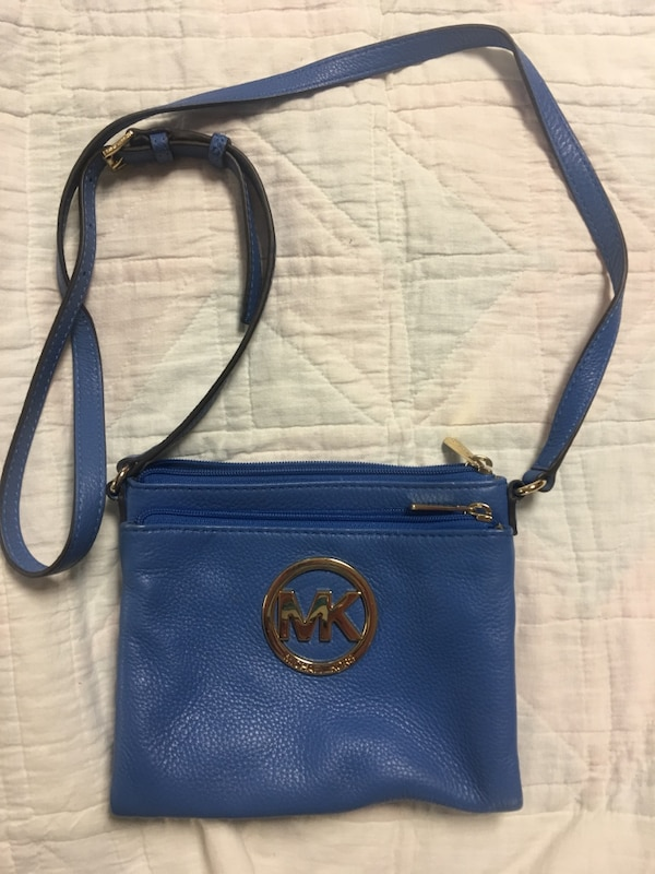 e4b5eb89620a Used Blue michael kors leather crossbody bag for sale in Marion - letgo