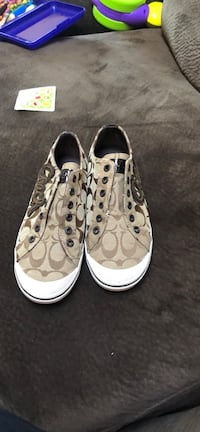 pair of brown-and-white Coach sneakers 235 mi