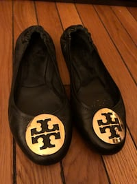 Pair of black tory burch leather flats