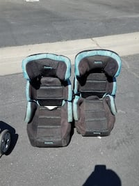 two teal-and-black suede infant car seats