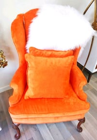 Wingback accent chair with matching pillows.