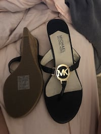 Pair of black-and-gold micheal kors real leather sandals Lakeland, 33810