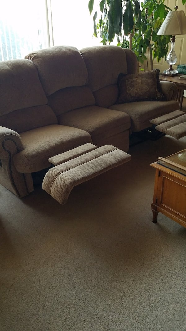 Couch. Very heavy. Reclining on left and right sides b3f7fcda-e7f5-4a10-9507-339015e16cda