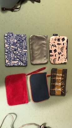 6 assorted wristlets and pouches
