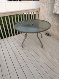Round gray metal patio table Edmonton, T5Z 0C6