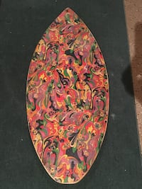 Red, green, and yellow floral vintage skim board