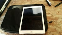 white iPad with black case 3131 km