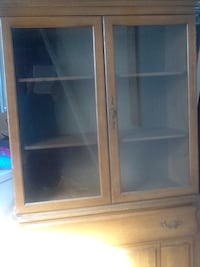 brown wooden framed glass cabinet Buford, 30519