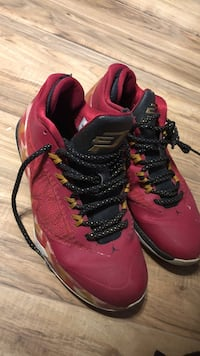 pair of red-and-black Air Jordan basketball shoes Bedford, B4A 3K4