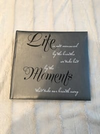brown wooden framed quote board 778 km