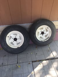 two white bullet hole car wheels with tires Toronto, M2M 1B3