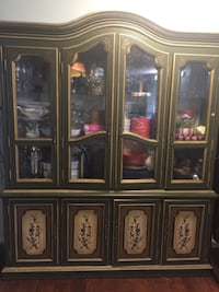 Brown wooden framed glass display cabinet. Houston, 77057