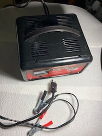 Black and red electronic device motor master battery charger