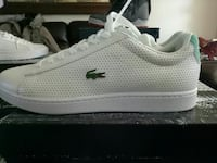 pair of white Lacoste lace-up casual sneaker