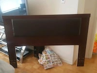 brown wooden dresser and nightstands and bed head