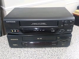 black and gray VHS player