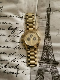 round gold analog watch with gold link bracele
