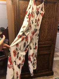 Burgundy one piece pants suit size and floral one piece pants suit.  Both brand new and never worn.  Still have the tags attached.  I have other dresses listed.   I'm willing to make a deal for the whole bundle  Raceland, 70394
