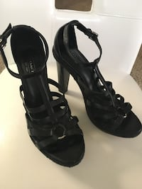 Gorgeous COACH straps heels with silver ring and braided detailing around entire shoe. Four inch wood heel, size 71/2, excellent condition.