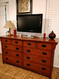 flat screen television with brown wooden dresser Annandale, 22003