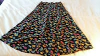 women's black, pink, and yellow floral patterned midi skirt Burnaby, V5H 2K3