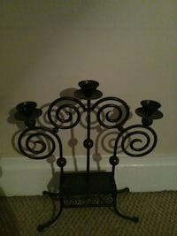 black metal candle holder with candle holders