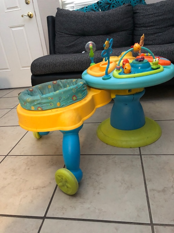 baby's yellow and blue activity saucer
