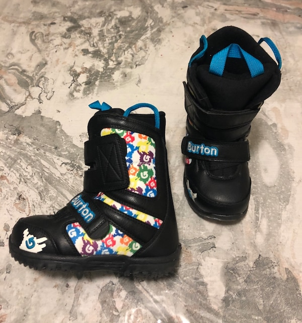 Pair of black-and-blue burton snowboard boots