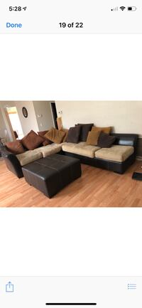 black leather sectional sofa with throw pillows Palmdale