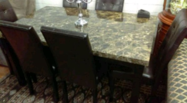 Brand New 7 Piece Faux Marble Dining Set  96b3c145-1cb9-4588-9f82-d28064b5d683