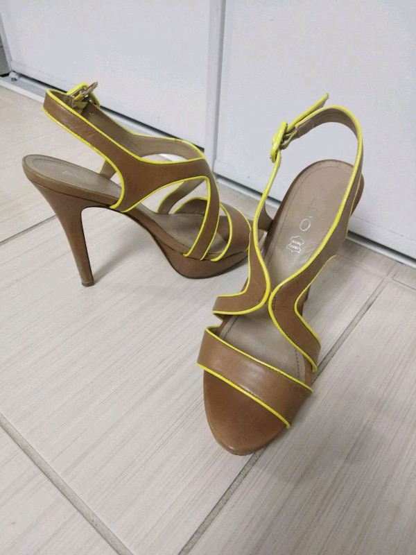 pair of open toe ankle strap heels a976790f-ee37-4ccc-b549-e99a1c2c8d88