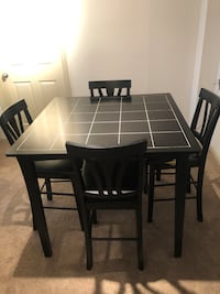 Bar height table and four chairs to match.