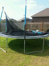 black and blue trampoline with enclosure Gulf Shores, 36542