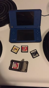 Blue nintendo 3ds with games and charger Barrie, L4N 7P8