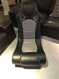 Gaming chair with complete wiring for speakers on chair