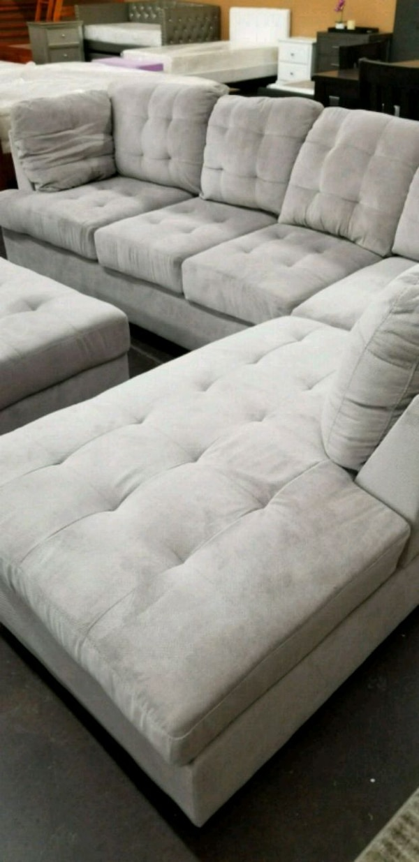 Used Medium Size Sectional With A Matching Storage Otto