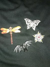 two silver-colored butterfly pendants Winter Haven