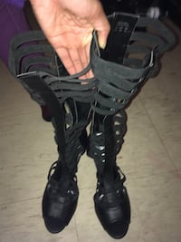 pair of black leather gladiator sandals Toronto, M9V 4C3