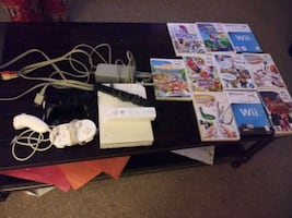 Wii controllers and cords plus 11 games