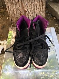 pair of black-and-purple Nike sneakers Palmdale, 93550
