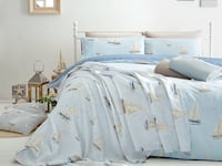 white and blue bed sheet London