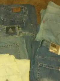 two blue and one gray denim bottoms St. Louis, 63123